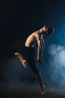 Ballerino dancing with tights and smoke