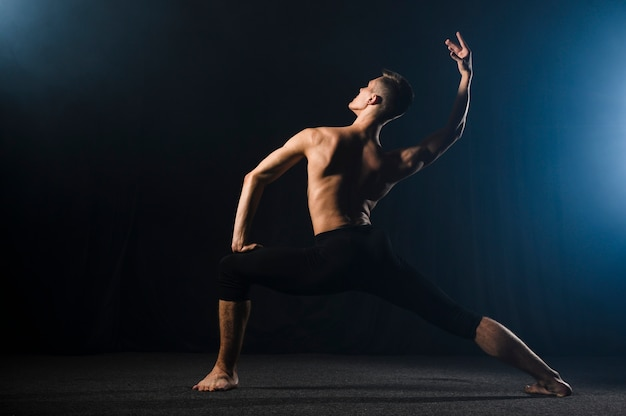 Ballerino posing in tights with copy space