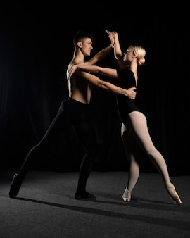 Ballet couple posing while dancing