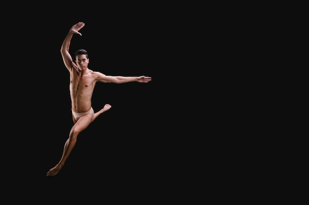 Ballet dancer leaping towards camera