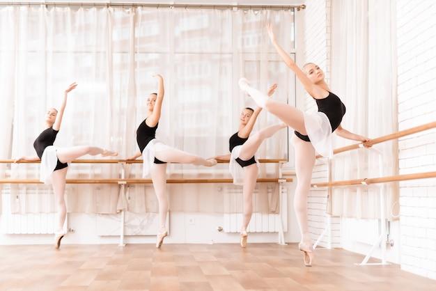 Ballet dancers rehearse in ballet class.