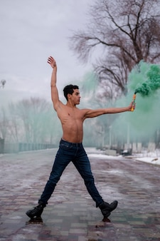 Ballet performer with green color powder