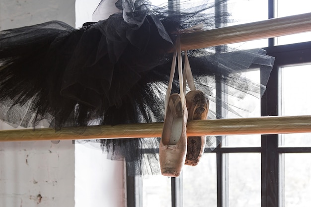 Ballet tutu and pointe shoes in the rehearsal room. old pointe shoes.
