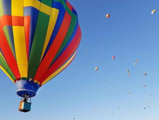 Balloon festival flying balloons in the summer blue sky