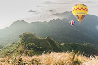 Balloon over fog and cloud mountain valley landscape