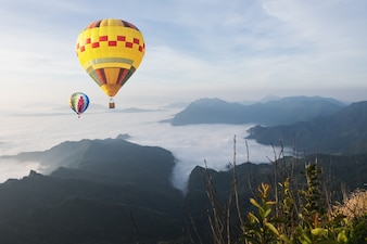 Balloon over fog and cloud mountain valley