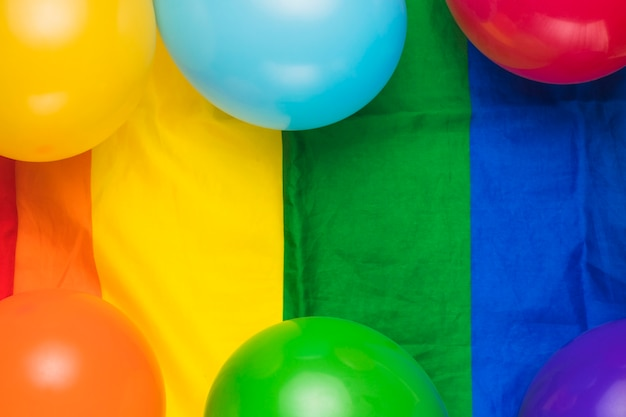Balloons on striped rainbow flag