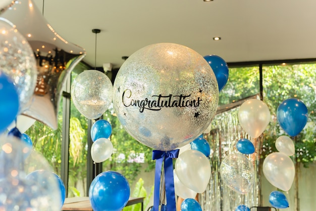 Balloons with word congratulation on ballon decoration in the restaurant.