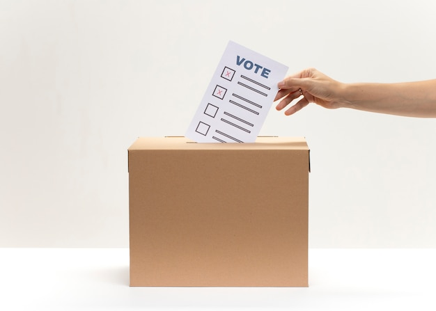 Ballot box and document with candidates