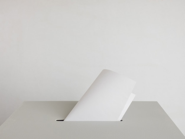 Ballot box with the ballot papers on gray background