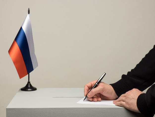 Ballot box with national flag of russia. presidential election in 2018. hand throwing a ballot