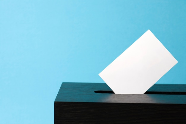 Ballot box with voting paper in hole