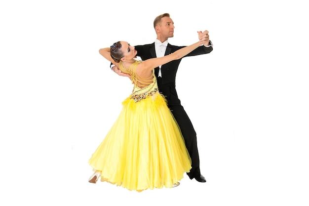 Ballroom couple dance in yellow dress dance pose isolated on black background ballroom dancers