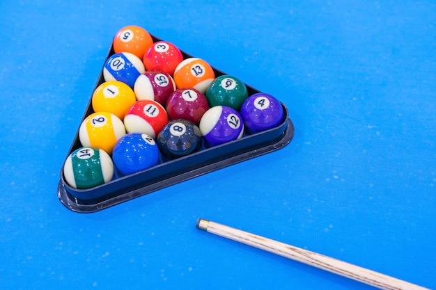 Balls for billiards pool snooker are on blue table