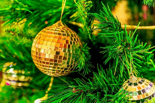 Balls on a green christmas tree decoration for new year and christmas closeup