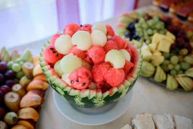 Balls of melon and watermelon put in a cover of green watermelon