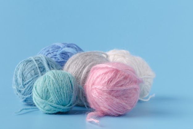 Balls of pink and blue yarn