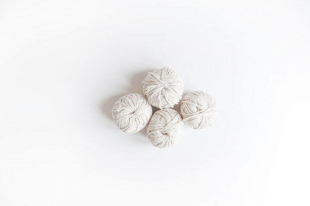 Balls of white yarn. isolated skein of wool boho logo. space for text