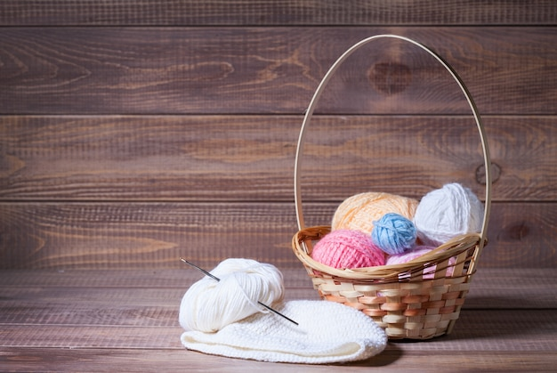 Balls of yarn for knitting on wooden boards