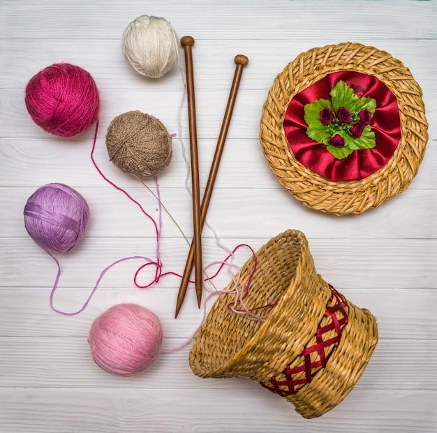 Balls of yarn on a wooden board