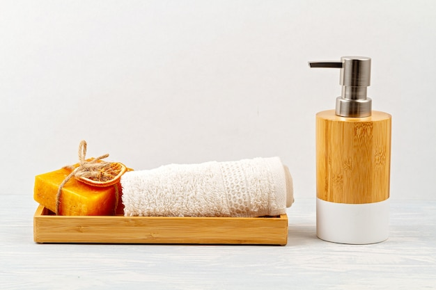 Bamboo acessories for bath - bowl, soap dispenser, brushes, tooth brush, towel and organic dry shampoo for personal hygiene