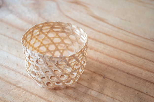 Bamboo basket on wooden texure