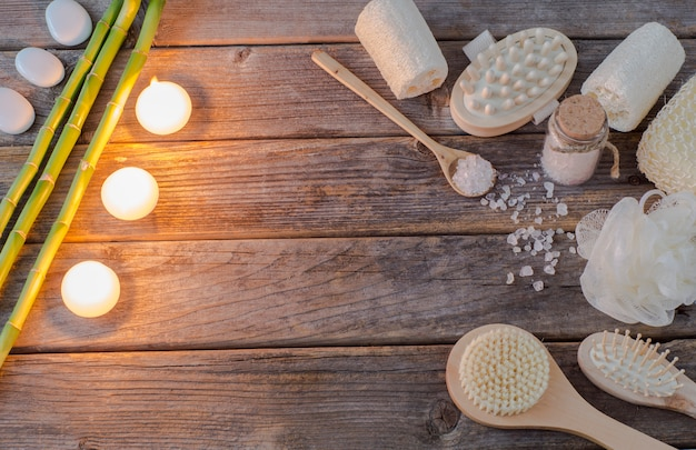 Bamboo branches, candles, sea salt, brushes, sponges and stones (spa)