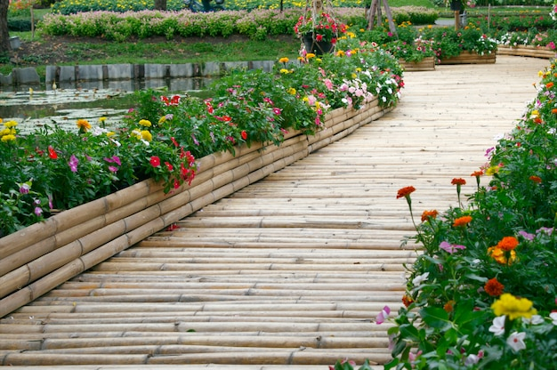 Bamboo bridge with flower on the pond