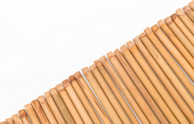 Bamboo chopsticks on white
