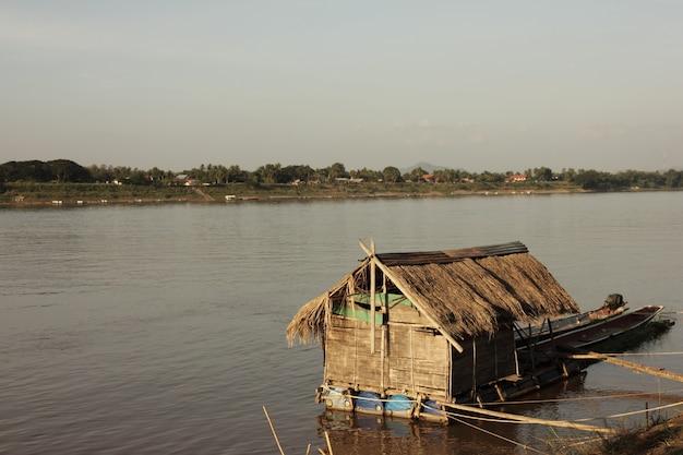 Bamboo hut on riverside in morning.