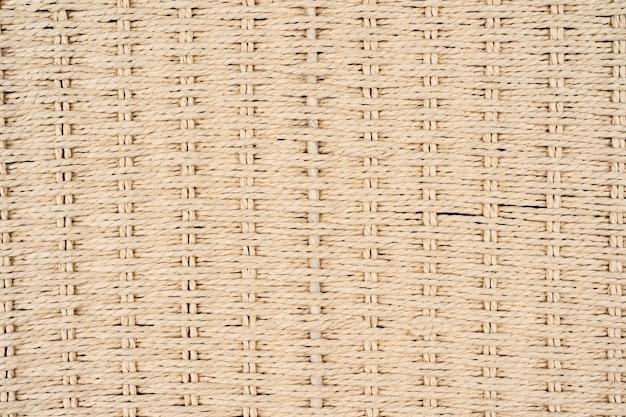 竹マットと生地の糸のパターンの背景自然な竹のテクスチャのクローズアップの壁紙