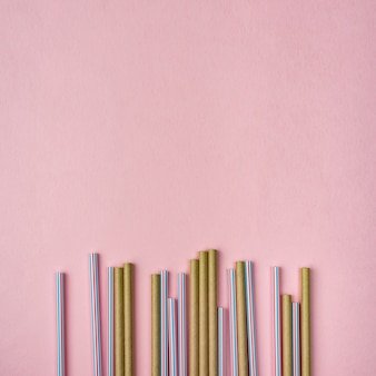 Bamboo and plastic straws copy space