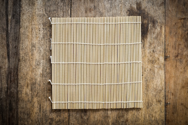Bamboo platemat on wooden background
