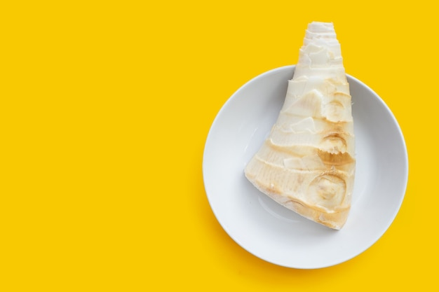 Bamboo shoot in white bowl on yellow background