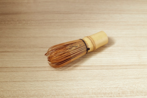 Bamboo tea whisk for matcha on wooden table