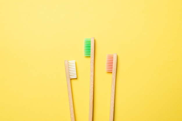 Bamboo toothbrush on a blue background. top view.