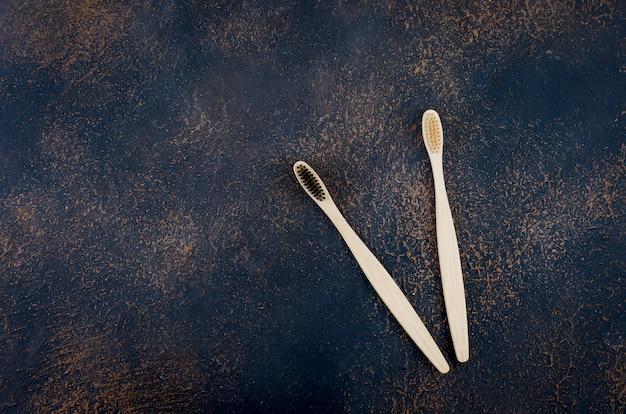 Bamboo toothbrush on dark concrete background
