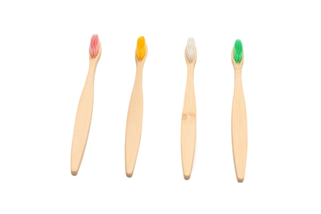 Bamboo toothbrush isolated on a white surface. top view.