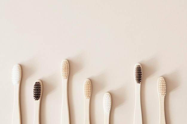 Bamboo toothbrushes on a beige background