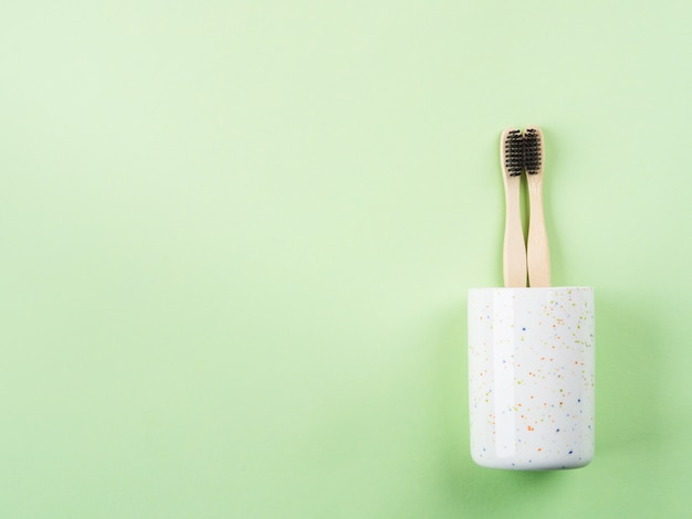 Bamboo toothbrushes for two in ceramic glass