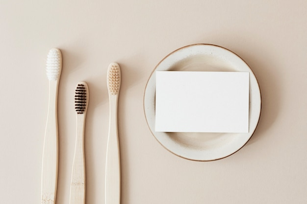 Bamboo toothbrushes and a white blank card