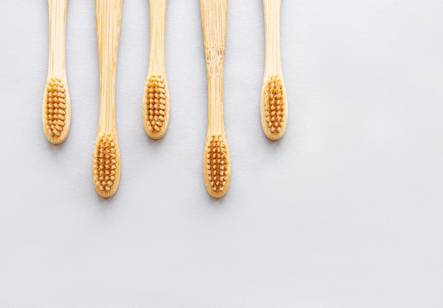Bamboo toothbrushes on white