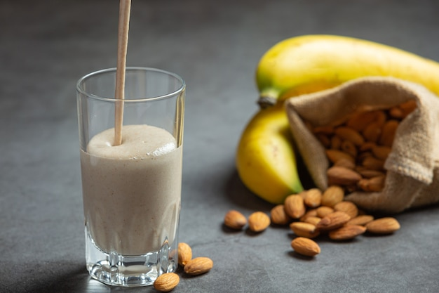 Banana almond smoothie on dark background