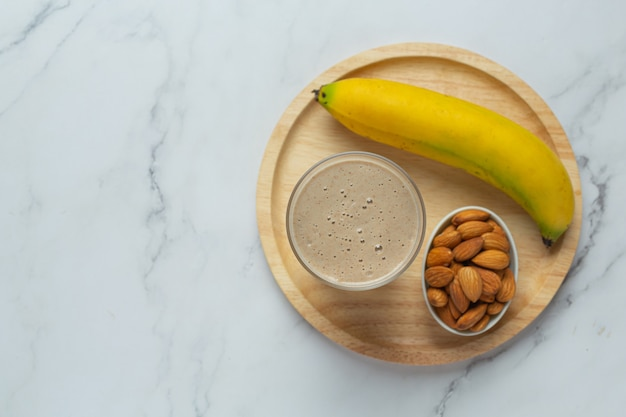 Banana almond smoothie on marble background