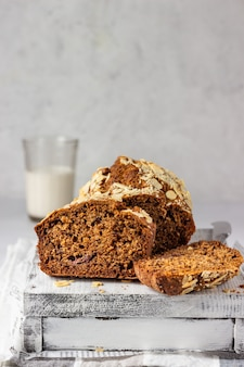 Banana bread with almond on a light grey wooden tray