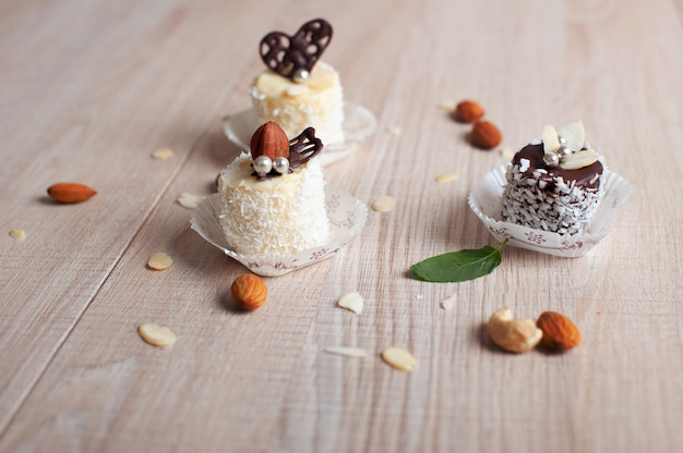 Banana covered with white and dark chocolate with coconut flakes, pearl beads and nuts