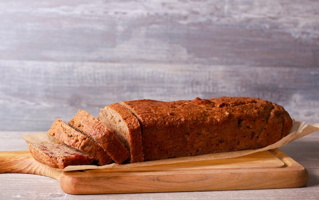 Banana and date whole wheat bread on board, sliced