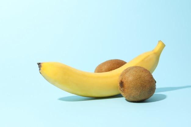 Banana and kiwi on blue table. fresh fruits