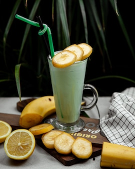 Banana milkshake with fresh banana slices
