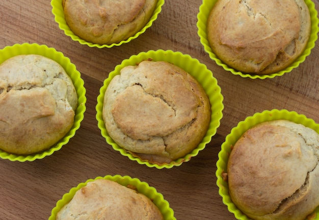 Banana muffins on a wooden background, top view